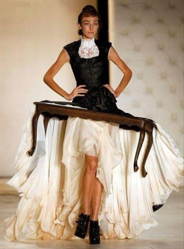 Never worry about having a writing surface or place to put your coffee ever again! Just wear this handy-dandy table-dress. It's great! (Except when you're trying to fit through doors.)