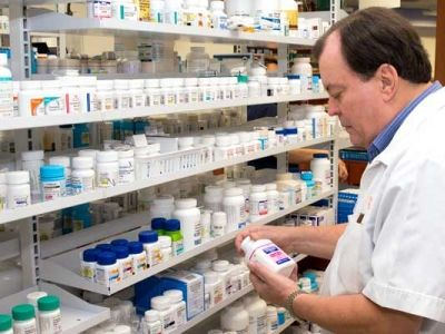 Prescription medication can be costly but there are ways to reduce your out-of-pocket expense. Discount cards or generic brands might help lower your cost at the pharmacy counter. (Photo by Ray Mata)
