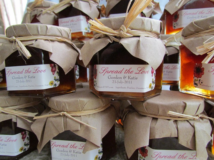 Mason jars filled with Honey or Jam for wedding reception favors for a country-garden themed wedding <3