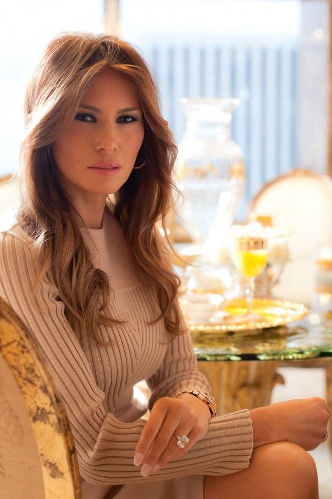 Here we see a fine example of the Surgically Preserved Eastern European Female relaxing in her natural habitat, the Egregiously Ugly and Outrageously Excessive Penthouse of her current husband.  The husband in question being one Donald Trump, a man who can afford to keep a stream of bimboes in diamonds and cashmere but who can't afford a decent hairpiece.  For God's sake, man, look in a mirror and fix your hair!