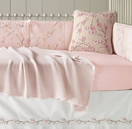 Cherry blossom nursery; this one is sweet. ♥ I like this bedding set, shown in the next pic with the drape. One of my favorites. but this doesn't give you that contemporary/modern room that you first described.