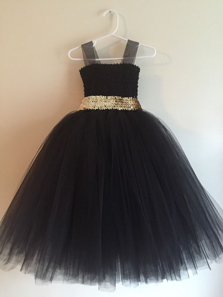 Black tulle flower girl dress with gold sequin sash!  A personal favorite from my Etsy shop https://www.etsy.com/listing/290506669/black-tulle-flower-girl-dress-sequin