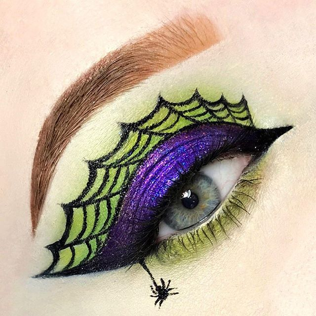 """WEBSTA @sevreds  Witchy Web  A basic Halloween look I did to try to get myself back in the grove of doing looks  Inspo: @giuliannaa  Using:  @katvondbeauty foundation in light 42 neutral, lock-it concealer cream in """"white out"""", saint and sinner palette shades """"exodus"""" and """"exorcism"""" glimmer veil shades """"razzle"""" And """"revereb"""" combined to make the purple on the lid, and tattoo black liner in trooper.  @wunder2cosmetics brow gel in Auburn  @nyxcosmetics face and body purple glitter ("""