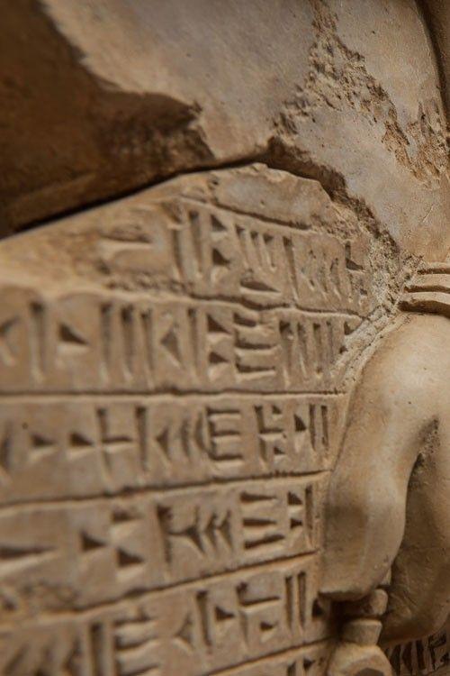 The art replica of an assyrian eagle-headed god Nisroch bas relief. Details. Engineered concrete Danzare.CASA