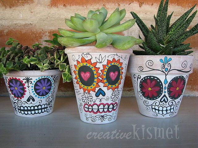 Day of the Dead planters are just painted terra cotta style pots.... could also be done with a plain white ceramic pot using the sharpie baking method.