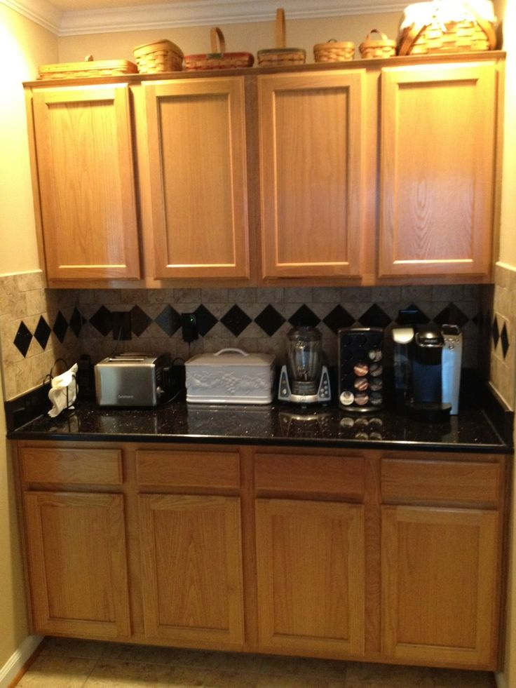 Black granite countertops with oak cabinets granite for Kitchen cabinets 60056