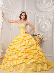 Gold Court Train Dresses for a Quince with Pick ups and Beading