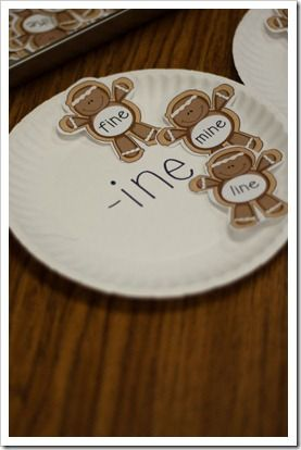 I programmed a bunch of little gingerbread men with the chunk words, cut them out, and placed them on a little cookie sheet. I labeled three paper plates with the chunks and the kids got to use a spatula to move the Gingerbread from the baking sheet to the corresponding paper plate.