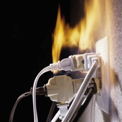 Overloaded Power Sockets: Plugging too many power cables into a socket can result in the socket being overloaded, overheating, and a fire starting.  Solution: Never plug too many cables into a socket. Always make sure there are fire extinguishers nearby