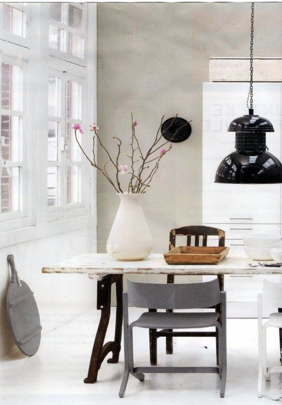 love that table and shiny white cabinets look great with the grey wall and the rest of the room