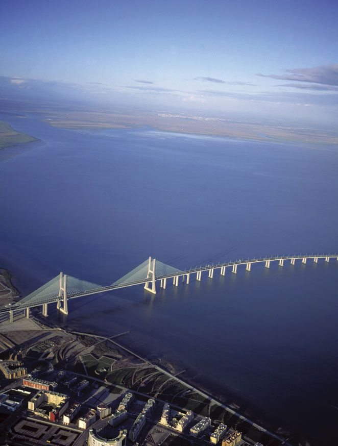 The BreathTaking Vasco de Gama Bridge Across Tagus River , Lisbon, Portugal