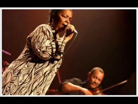 """One of my favourites of many of this wonderful ladies songs Cesária Évora, a canção """"Sombras di Distino"""" a partir do álbum """"Rogamar"""" 2006.    Cesaria Evora, the song """"Sombras di Distino"""" from the album """"Rogamar"""" 2006."""