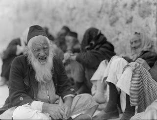 "Tisha B'Av Jewish men sitting on the ground at the ""Wailing Wall"" (circa 1935)"