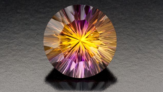 This 44.00 ct ametrine features concave facets that combine to mix the color of the purple and gold, producing a beautiful effect.