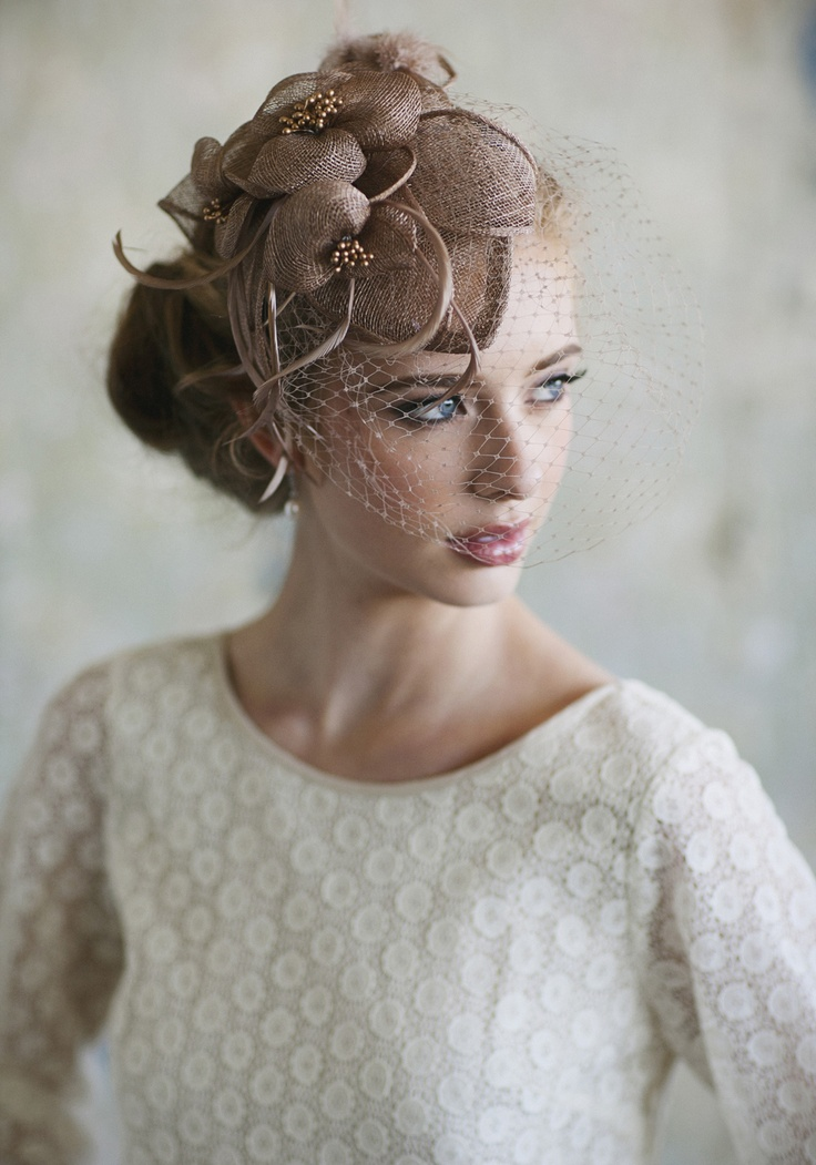 """Ever Thine Taupe Fascinator 42.99 at shopruche.com. A caged veil exudes vintage romance on this taupe raffia fascinator with matching feather accents, bronze hued details, and a wired rim for structure.  10"""" x 12"""""""
