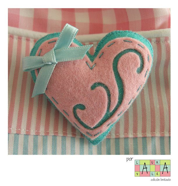 Pink and aqua felt heart. Cool idea to cut out some of the felt, second color shows through perfectly.