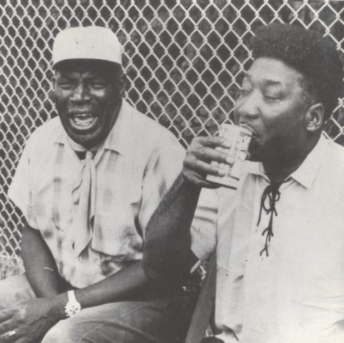 howlin wolf & muddy waters / camera talkin' and beer sippin' posture