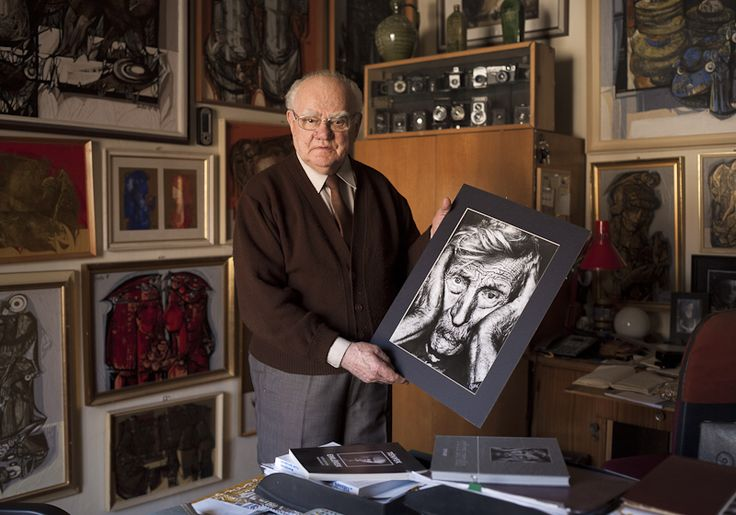Tóth István - Famous hungarian photographers posing with their most iconic works.
