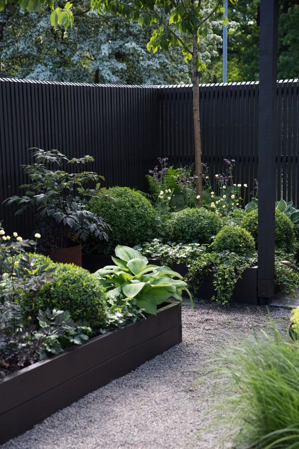 black fence and raised planters