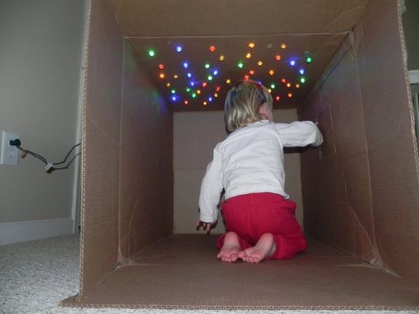 """""""a cave of stars - just poke Christmas lights through the top of an old box and add some pillows and snacks.""""."""