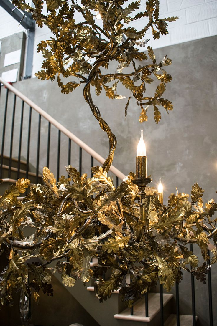 Luxurious gold oak leaf chandelier - Beautiful hand crafted sculptural furniture and lighting designs from Cox London. Luxury pieces feature on www.martynwitedesigns.com during a tour of the studio and workshop in North London.