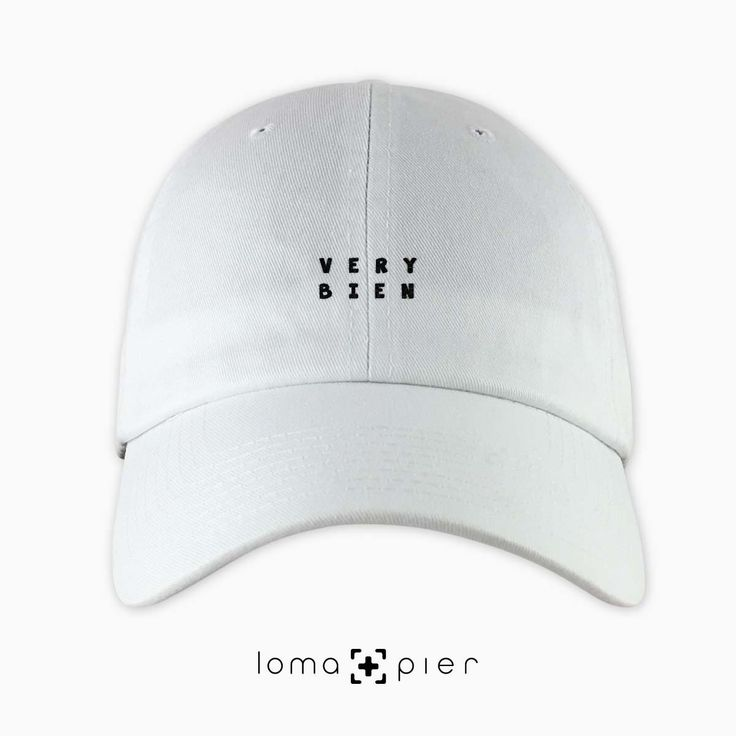 VERY BIEN typography embroidered on a white unstructured dad hat with black thread by loma+pier hat store made in the USA. VERY BIEN dad hat is 100% cotton unstructured with a pre-curved bill and an adjustable self strap with a hide-away side buckle. it features VERY BIEN typography embroidered on the front with a small loma+pier logo on the left side. each order is custom made in the USA and can only be found in the loma+pier hat store.
