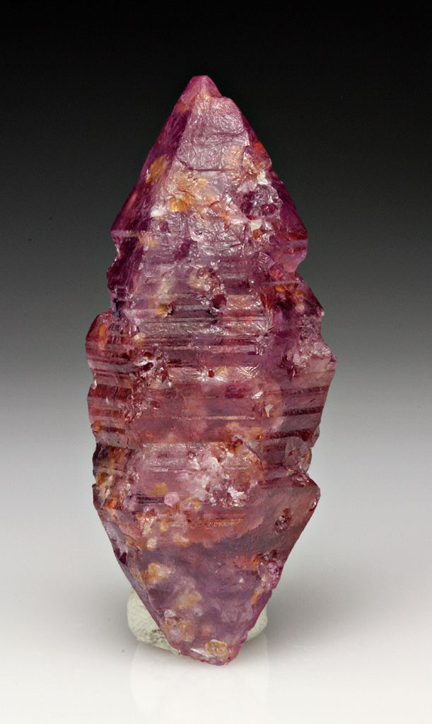 Corundum var. Ruby, elestial: Corundum is best known for its gem varieties, Ruby and Sapphire. Ruby and Sapphire are scientifically the same mineral but just different colors. Corundum is a very hard, tough, and stable mineral. For all practical purposes, it is the hardest mineral after Diamond, making it the second hardest mineral. It is also unaffected by acids and most environments.