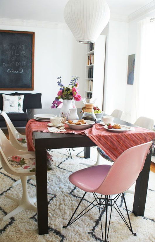 LOVE!!!! This space was featured in West Elm catalog- here's the blog source on the owners space. LOVE pink, black and white dining. Love the George Nelson bubble lamp, LOVE the west elm rug!!!!, LOVE the tulip chairs and my goodness do I LOVE the 2 pink Eames lucite chairs flanking the black Parsons table. ~GirlNesting