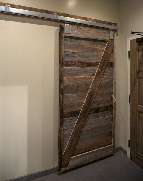 Rustic wood sliding barn door inside Columbia, S.C. Italian restaurant Pasta Fresca. Full-scale commercial interior design by MACK Home.