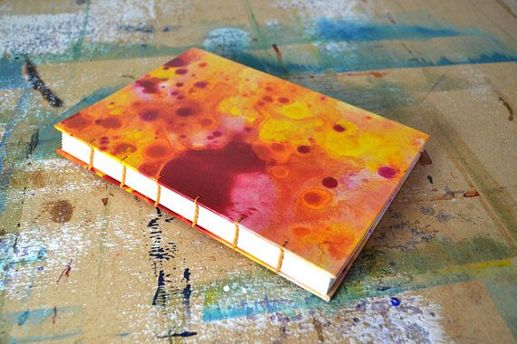 If you are looking for a journal thats a little bit different, look no further! This beautiful book holds 96 pages of thick, white, unlined 140gsm cartridge paper, suitable for all media. It has a beautiful revealed Coptic-Stitch binding and unique hand painted cover. Whether you want to jot down ideas, write a novel or sketch your surroundings, this hand-painted, handcrafted journal is completely unique, just like you