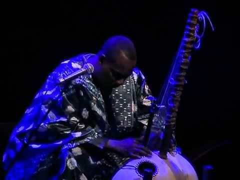 KORA INSTRUMENT / AFRICAN CLASSICAL MUSIC    A kora is built from a large calabash cut in half and covered with cow skin to make a resonator, and has a notched bridge. It does not fit well into any one category of western instruments and would have to be described as a double bridge harp lute. The sound of a kora resembles that of a harp, though...
