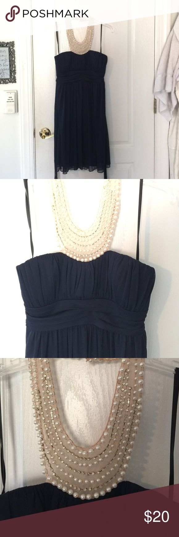 Navy cocktails dress Navy cocktail dress, with sheer beaded neckline. Great for weddings! City Triangles Dresses