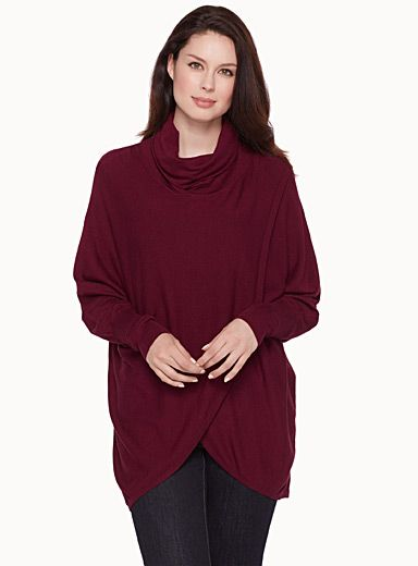 Exclusively from Contemporaine     Cocoon-like piece with a wide turtleneck and batwing sleeves   Fashionable loose style made with a crossover design in front   Ultra comfortable, fine, soft stretch knit    The model is wearing size small