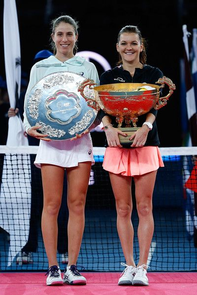 ♔♔Johanna Konta of Great Britain holds the runner up trophy next to Agnieszka Radwanska of Poland who holds the winners trophy after the Women's Singles final on day nine of the 2016 China Open at the China National Tennis Centre on October 9, 2016 in Beijing, China.