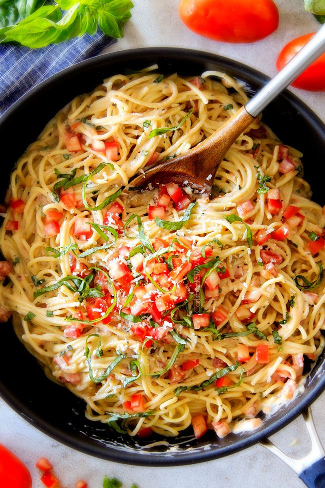 25 Minute LIGHTENED UP Margherita Pasta bursting with fresh tomatoes and basil in a garlic, mozzarella Parmesan sauce! Your favorite pizza in pasta form!