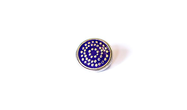 This Mila + Ruby pebble features a traditional Aboriginal method of 'dot' painting and is circular to represent a 'Campsite or Meeting Place', meaning 'Together'.  Made from royal blue and gold metal with deco colouring.  Individually handcrafed in Nepal.