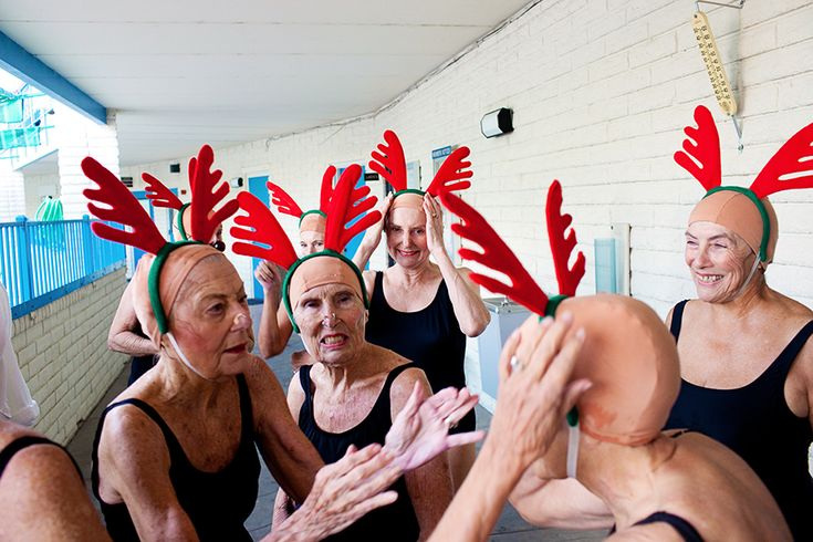 Members of the Sun City Aqua Suns, a synchronized swim team of retirees, wait for their cue for a holiday reindeer routine in the Lakeview Recreation Center pool. Their performance was a part of the Holiday Around the World celebration in Sun City, Ariz., on Dec. 10, 2010. Kendrick Brinson