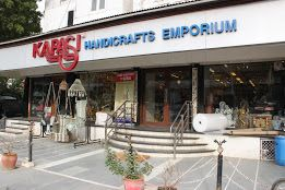 KAPASI Handicrafts Emporium has got it all under one roof, including pottery and handicrafts made out of brass and rare metal work, wall hangings, vases, marble art pieces and more. You'll be saved the hassle of bargaining for it's a fixed price shop.  Address: Jitendra Chambers  Behind Ajanta Commercial Centre  New R.B. I. Lane  Ahmedabad  380014  Gujarat