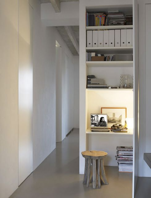 Great idea to put a study area and bookshelf behind what seems like a cupboard door. Great use of space.