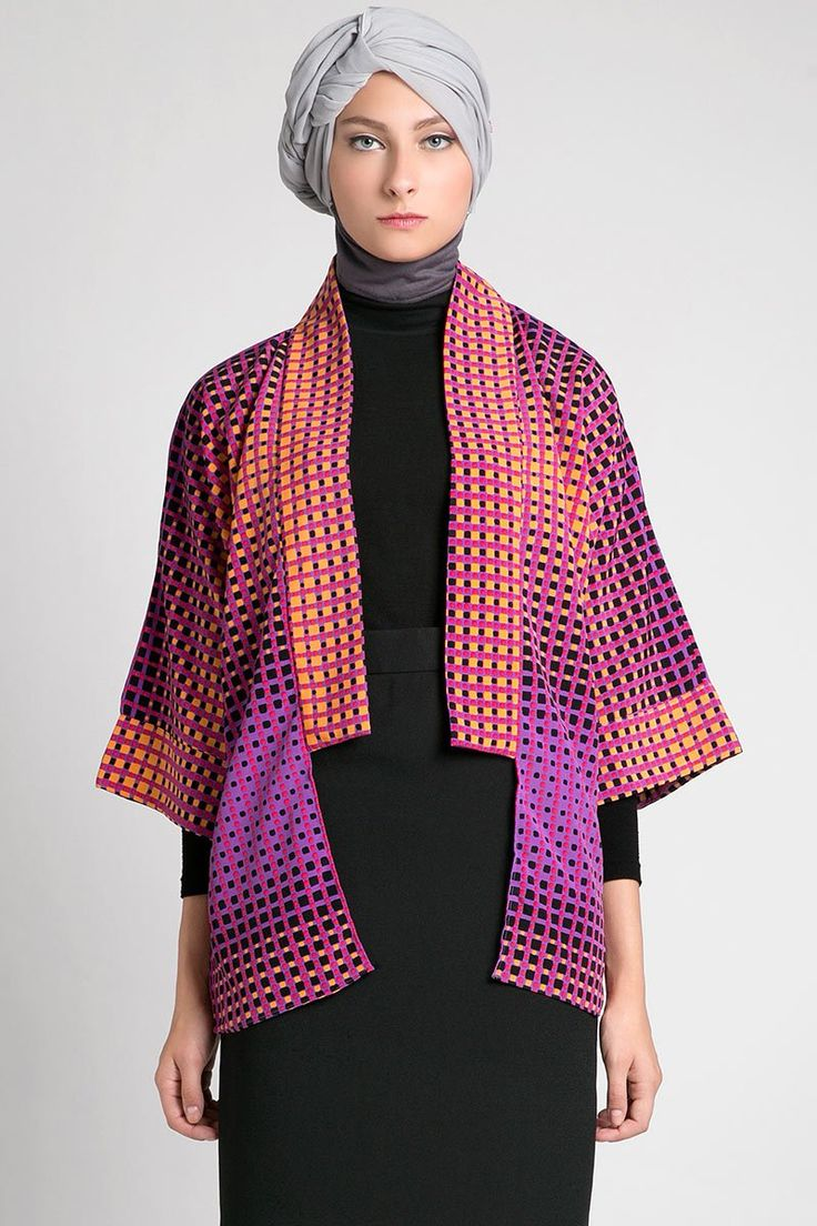 Elva Outer by AISHKA. Simple loose outerwear whit no closures, it has kimono sleeves and is perfect for casual look. With purple and orange color combination and abstract pattern, that make this kimono outer looks so unique. http://www.zocko.com/z/JEnPI