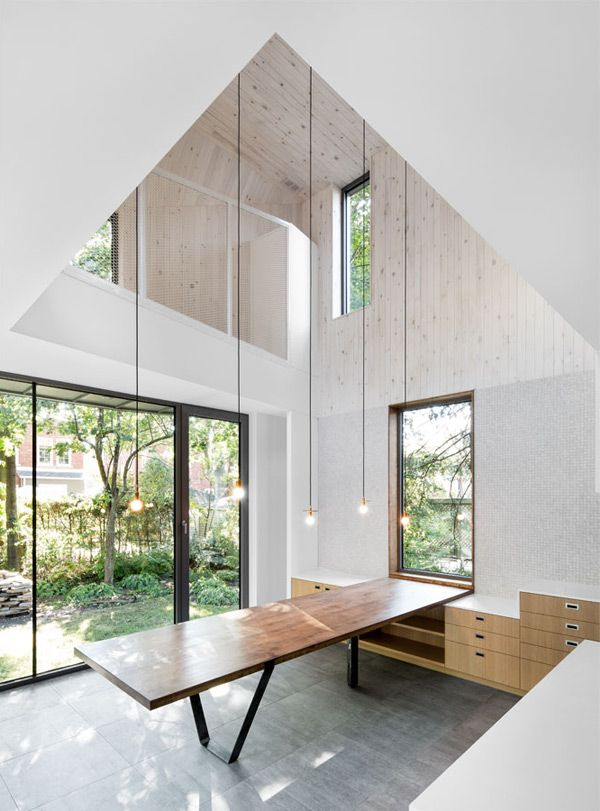 This contemporary extension by naturehumaine is quite the juxtaposition. The owners needed more space than their small 1920's house but they wanted something more modern