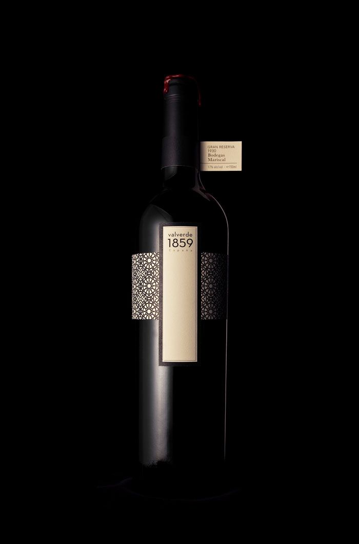 Student wine bottle design. Dramatic and graphic. Love!