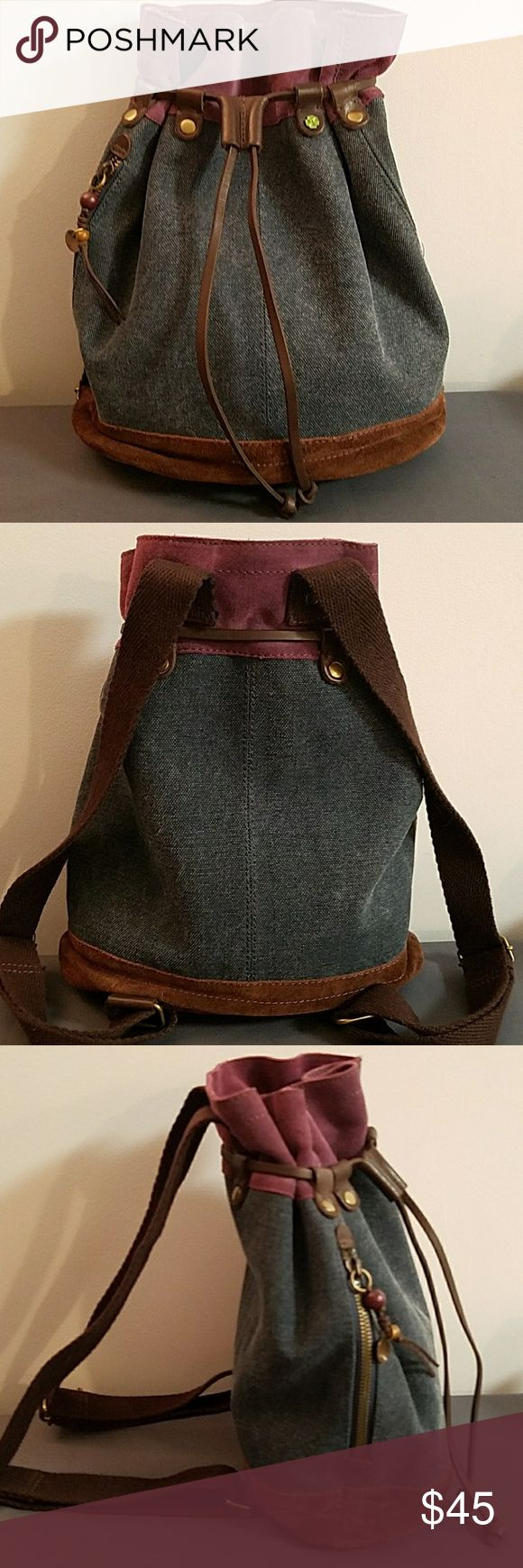 """Lucky Brand Drawstring Backpack Great Condition Really NICE pre-owned condition w/a couple barely noticeable fades. 1-Main Compartment that's fabric lined w/1-zipper pocket& 2-slide pockets on sides. Purple, brown,&denim. Gold tone hardware &the signature shamrock accent! 13""""Wx16""""Tx6.5""""D. @17""""-33"""" adjustable brown cotton straps. We want you to be happy so please ask questions. No bad odors. Sorry, but no trades. Lots of NEW &Pre-Owned Items in our closet so please see our bundle option.Thank…"""