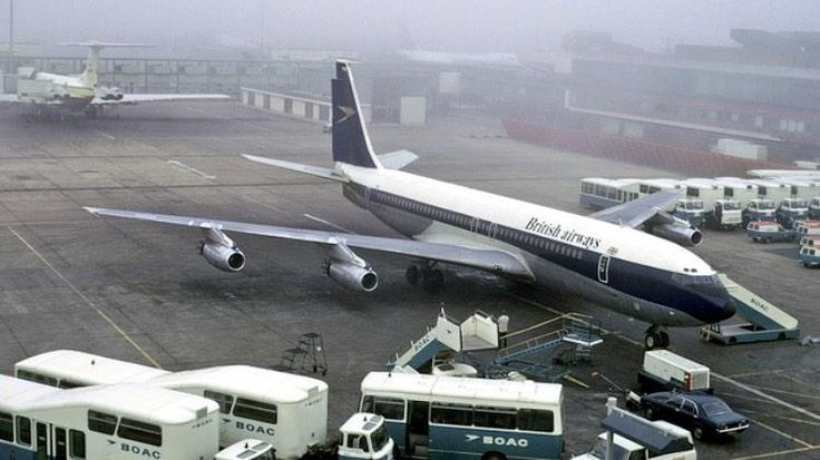 B707 G-APFM in BOAC colours but titled British Airways, on a misty morning at Heathrow!