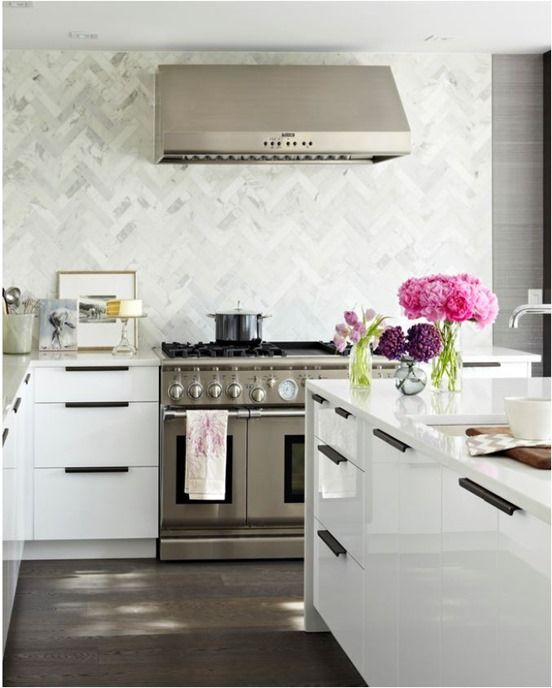 Kitchen trends that are here to stay...marble chevron tile to ceiling