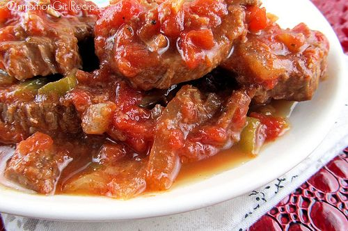Swiss steaks made by slow braising round steaks in tomatoes, peppers and onions until they are fork tender and melt in your mouth. With a thick and chunky sauce this is delicious served over rice, noodles and mashed or baked potatoes.