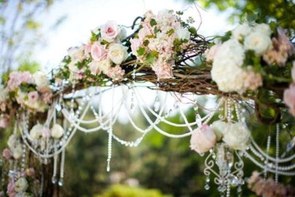 mason jars with pearls and lace | ... delicately decorated wedding arch… grapevines, roses and pearls