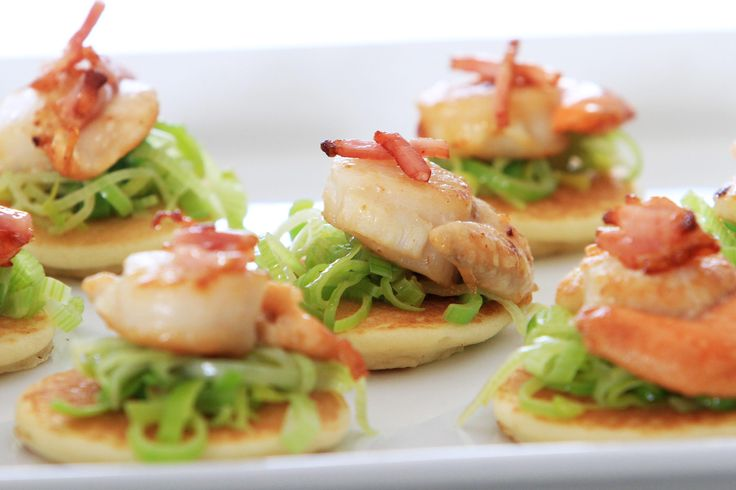 Pan Fried Scallops and Leek Blinis topped with Bacon. Made with Marcel's Fancy Blinis.