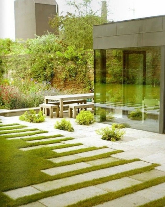 rectangle pavers used to create varying heights horizontally on grassed lawn projecting away from building and path