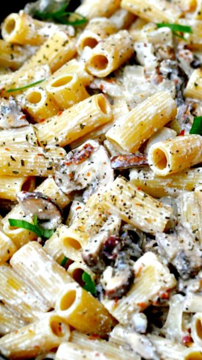Bacon, Mushroom, Chicken Pasta Recipe: a creamy garlic ricotta sauce smothering hearty rigatoni pasta, with a hefty helping of mushrooms and chicken, oh and crispy bacon... Oh good gravy, it's to die for.